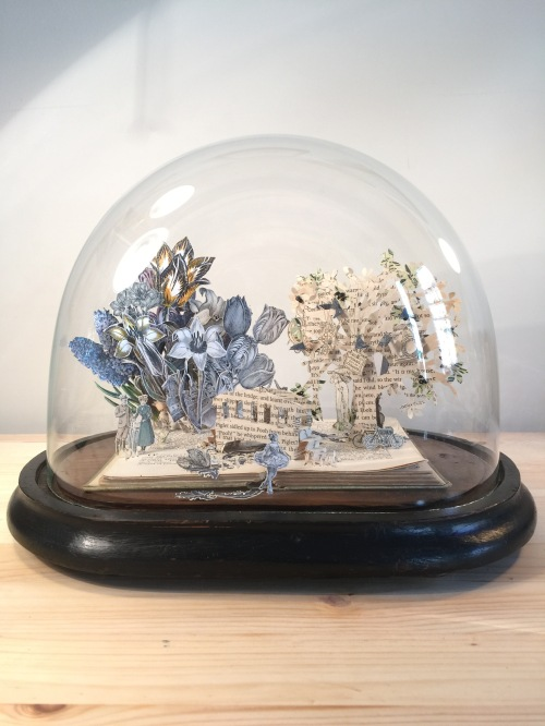 Paper world in a bell jar